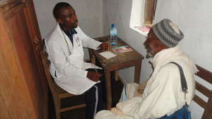 Fulani Community Member being consulted medically.
