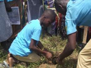 Club P.A.N. children planting trees