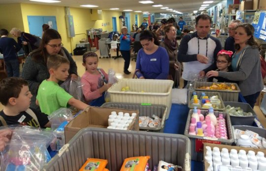 Families packing newborn supplies