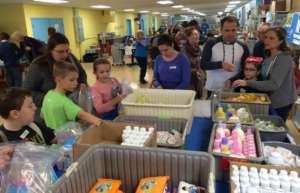 Families packing newborn supplies