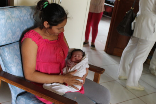 Patricia and her baby resting at Casa Maurita