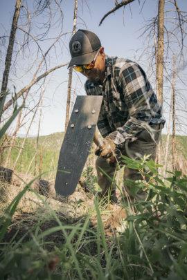 Derwin, Pueblo of Jemez Forestry digging a hole
