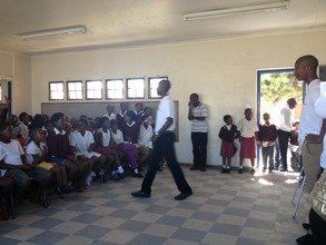 Bongani, Chris and Andile leading the children.