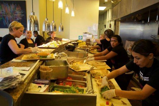 Food prep at Homegirl Cafe
