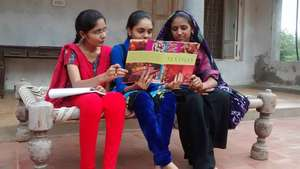 Tarannum, Marlin and Bhavana broswe through books