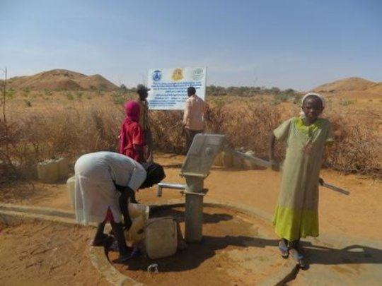 Collecting water in Darfur