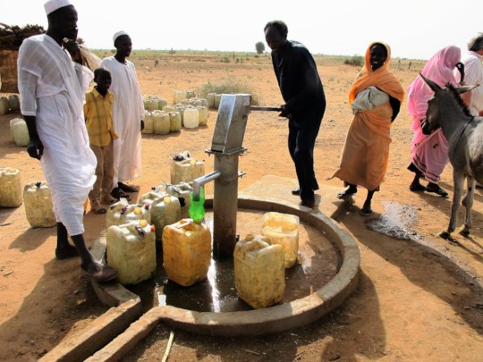 A community filling their jerry cans in Darfur