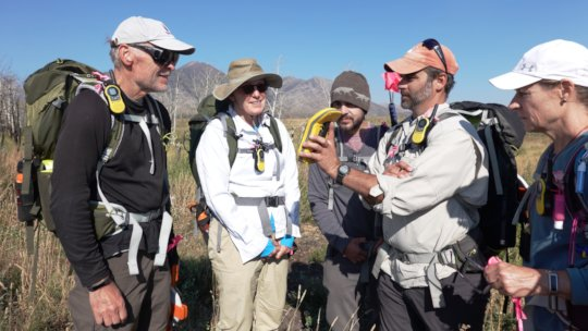Earthwatch volunteers learn to use a mapping tool
