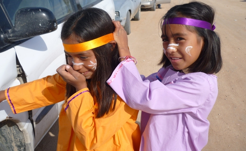 Two little tohono girls in traditional dresses