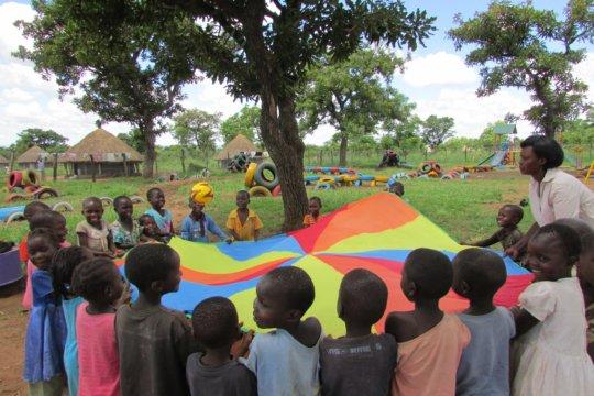 Nursery class - parachute play May 2016