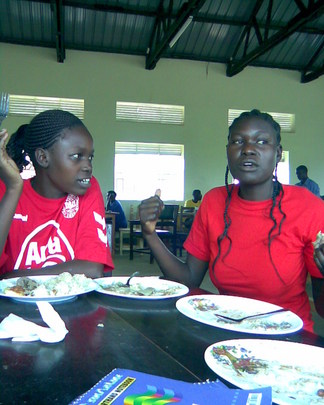 Knight Atieno  (Right)in Uganda at a youth camp