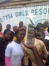 Girls admire the award