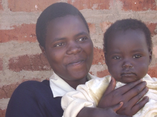Metrine with her 2 year old girl