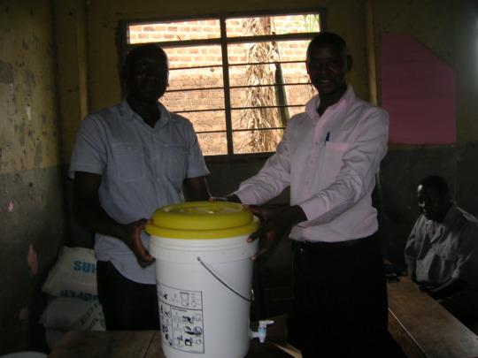 James hands over water purifiers to headteachers