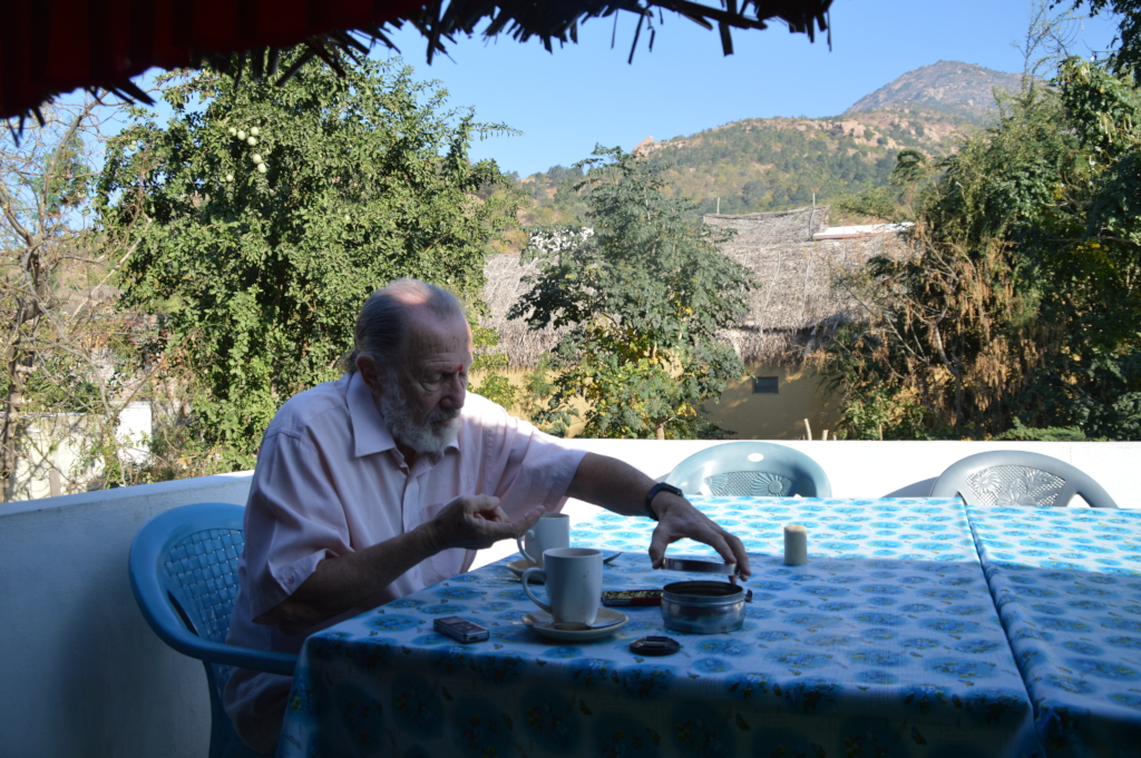 Leslie at breakfast, at foot of sacred Arunachala.