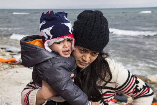 A woman and child landing in Lesvos