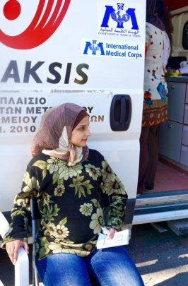 Muna outside of a mobile medical unit