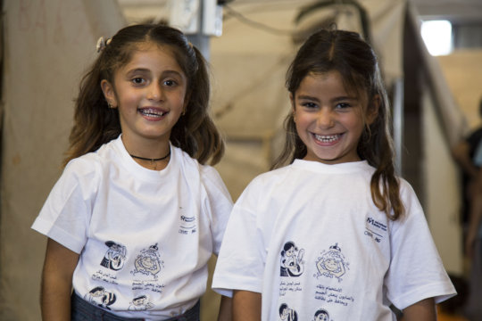 Children wear shirts that teach them hygiene tips