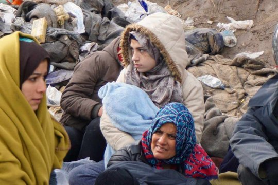 Refugees bundled up in Serbia