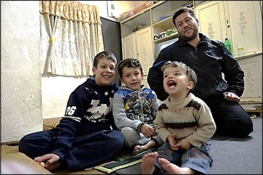 Omar with his father and brothers