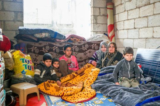 Nesreen and her children. IHSAN/CARE