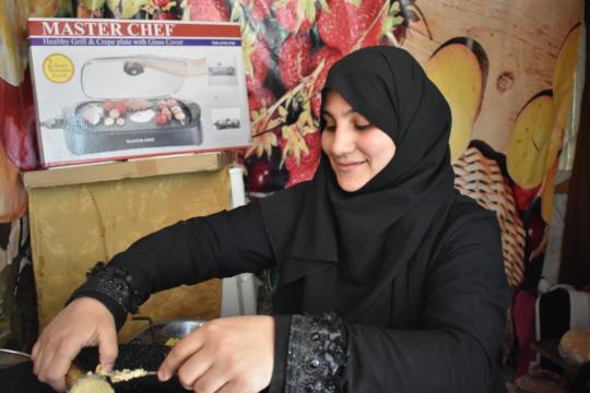 Iman preparing falafel
