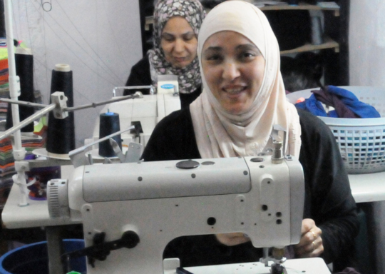 Rashedeh in her tailoring shop
