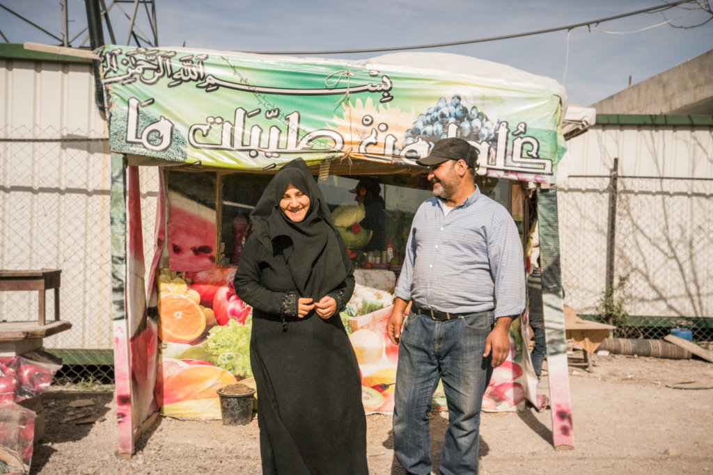 Iman and Ahmed in front of their Falafel stand
