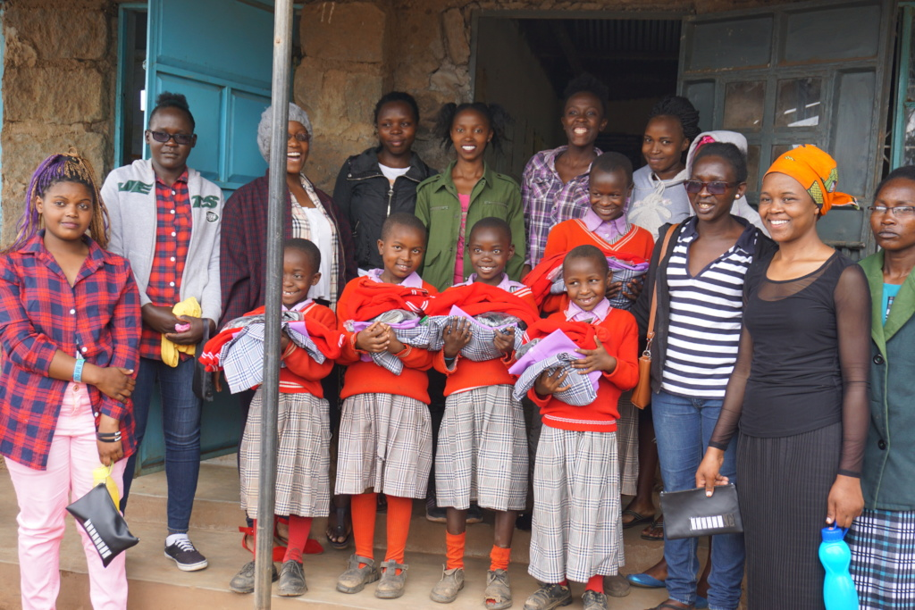 Our tailoring students with some of the young girl