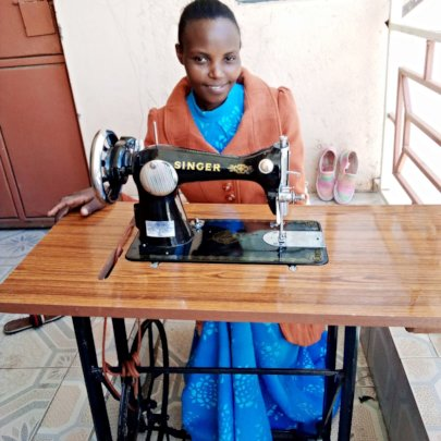 Susan proudly showing her new sewing machine