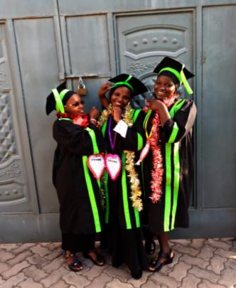 Susan & fellow recent Kijiji Mission graduates.