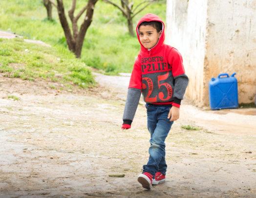 Kareem walks to Concern's learning center