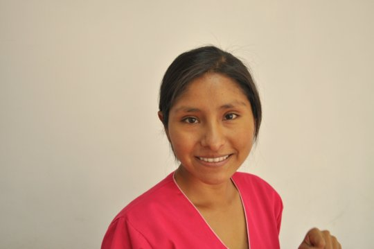 Aracely in bright pink scrubs