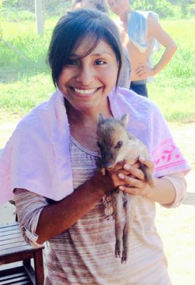 Aracely with wild piglet