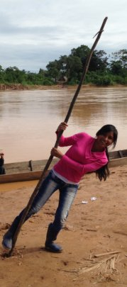 Aracely polling the river in Bolivian Amazon
