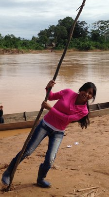 Aracely playing on the Bolivian riverbank