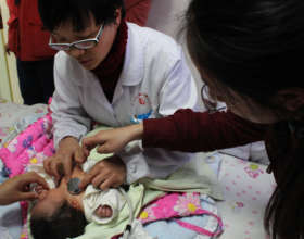 Dr. Zhao trains a nurse in newborn auscultation