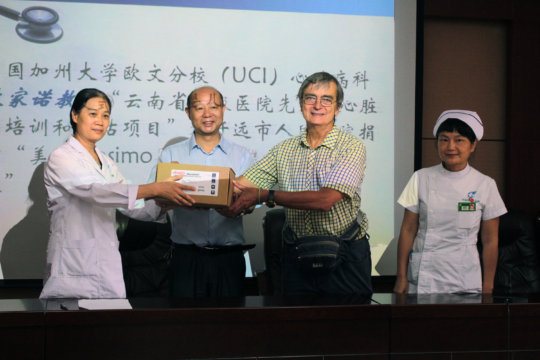 Presenting gift to local hospital directors