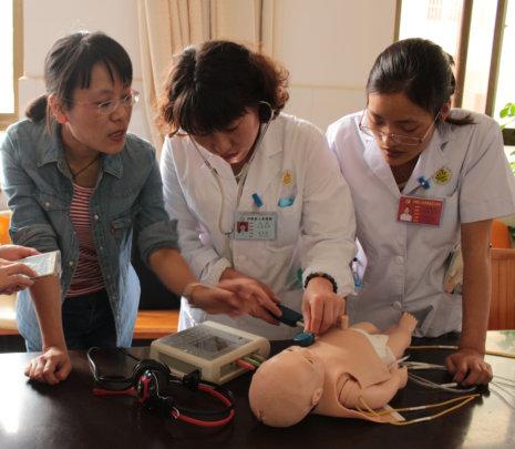 Dr. Li teaches a group of OB physicians