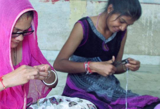 Women trainee learn handicraft skills