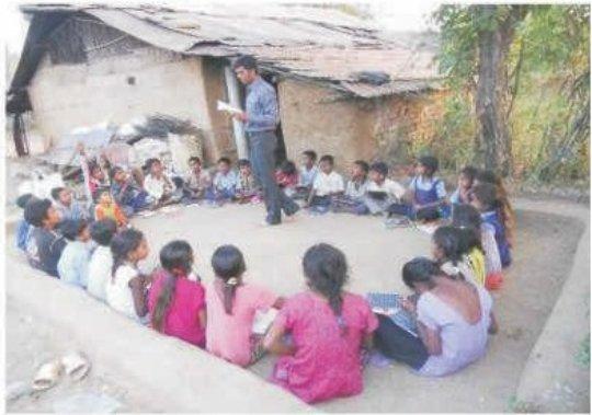 Para teacher teaching children in class room