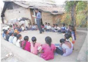 Para teacher teaching children in class room