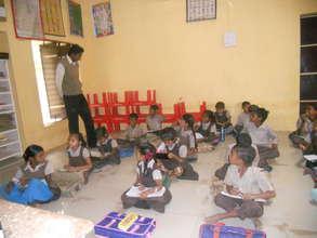 Para teacher performing his duty