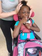 Our little Grace with our physical therapist