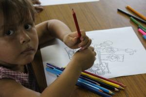 Janoriz's youngest student drawing school supplies