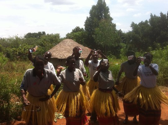 Traditional tribal dance with male & female condom