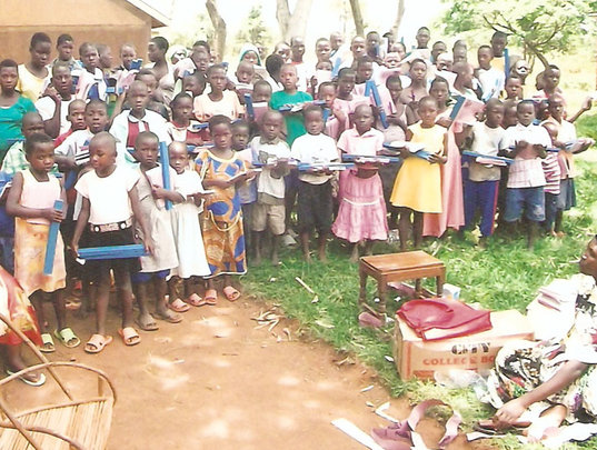 Children receive school supplies