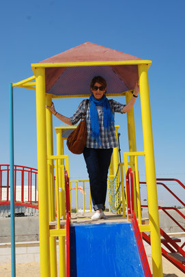 Board Member, Souzan Jaber, trying out the slide!