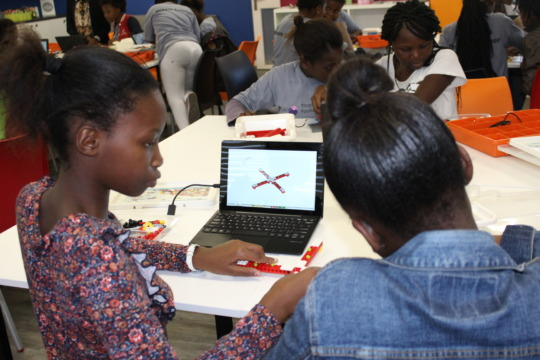 Agxobile and Othembele constructing a carousel