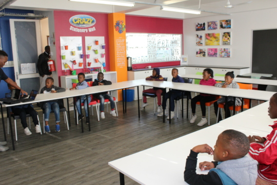 Children waiting as the netbooks are given out